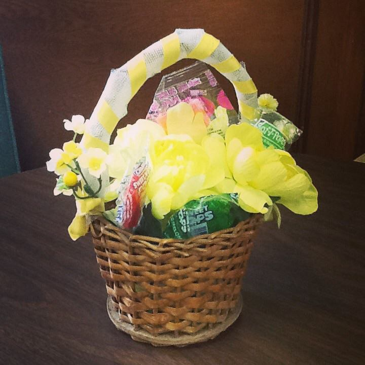 May basket with yellow ribbon and flowers